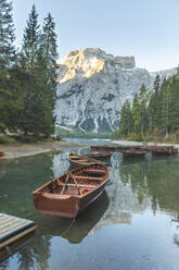 Rowboats moored at Braies lake against mountain, Italy - WPEF01834