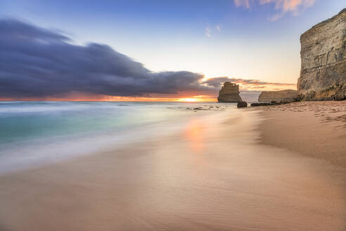 Scenic view of sea at Gibson Steps against cloudy sky during sunset, Victoria, Australia - SMAF01413