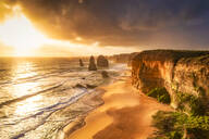 Scenic view of sea against cloudy sky at Twelve Apostles Marine National Park during sunset, Victoria, Australia - SMAF01416