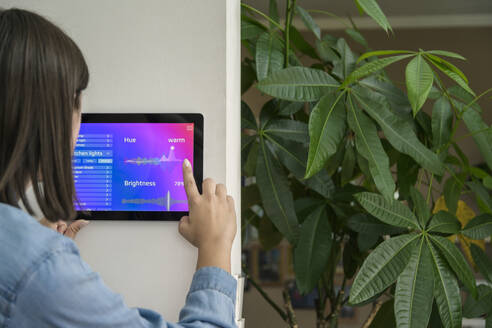 Young woman with tablet with smart home control functions - UUF18842