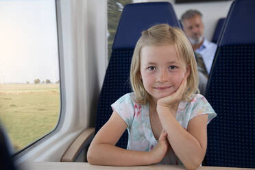 Little girl traveling by train - FKF03612