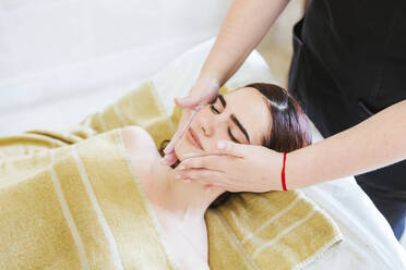 Young woman receiving facial beauty treatment in a spa - LJF00860
