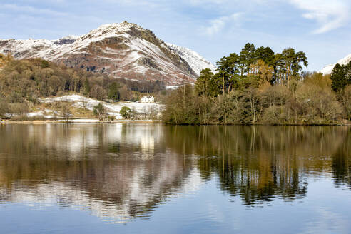 A perfect reflection of snow covered mountains and sky in the still waters of Grasmere, Lake District National Park, UNESCO World Heritage Site, Cumbria, England, United Kingdom, Europe - RHPLF04748
