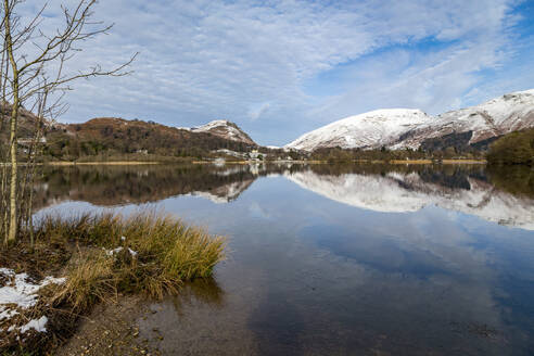 Shoreline and perfect reflection of snow covered mountains and sky in the still waters of Grasmere, Lake District National Park, UNESCO World Heritage Site, Cumbria, England, United Kingdom, Europe - RHPLF04751