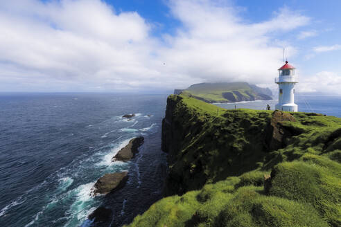 Lighthouse on islet known as Mykines Holmur, Mykines Island, Faroe Islands, Denmark, Europe - RHPLF04850
