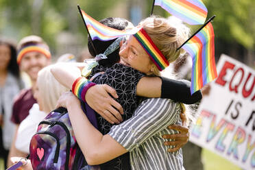 Couple embracing at gay pride festival - HEROF38008