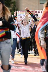 Student marching with arm sraised at gay pride festival - HEROF38014