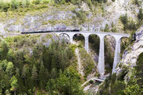 Steam train crosses the Landwasser Viadukt, UNESCO World Heritage Site, Filisur, Albula Valley, Graubunden, Switzerland, Europe - RHPLF05411