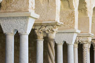 Row of columns and finely carved capitals in cloister of the Arab-Norman cathedral, UNESCO World Heritage Site, Cefalu, Palermo, Sicily, Italy, Mediterranean, Europe - RHPLF05909