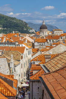 View of red rooftops and Dubrovnik Cathedral, Dubrovnik Old Town, UNESCO World Heritage Site, and Adriatic Sea, Dubrovnik, Dalmatia, Croatia, Europe - RHPLF06062