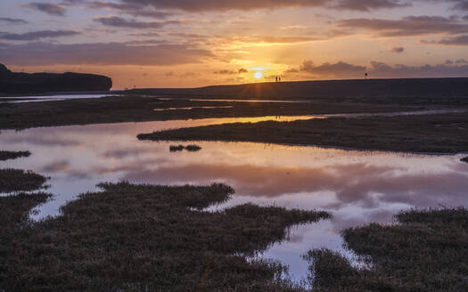 Dogwalkers have a sunrise chat with perfect reflections on the River Otter at Budleigh Salterton, Devon, England, United Kingdom, Europe - RHPLF06347
