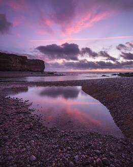 Dawn clouds at mouth of River Otter at Budleigh Salterton, Devon, England, United Kingdom, Europe - RHPLF06365