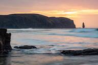 Am Buachaille sea stack at sunset, Sandwood Bay, Scotland, United Kingdom, Europe - RHPLF06515