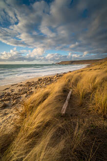Fence post in foreground, with Brissons and Cape Cornwall in the far distance, Sennen Beach, Sennen, Cornwall, England, United Kingdom, Europe - RHPLF06554