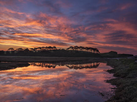 Twilight clouds with intense dawn colour and perfect reflections on the River Otter at Budleigh Salterton, Devon, England, United Kingdom, Europe - RHPLF06611