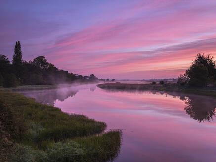 Dawn sky and rising mist from a mirror calm River Clyst at Topsham, Devon, England, United Kingdom, Europe - RHPLF06614