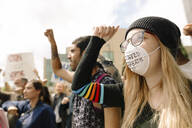 Student wearing pollution mask and marching against climate change - HEROF38462