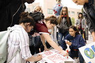 Multiracial students making climate change posters for demonstration - HEROF38465