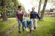 Playful multi-generation women in backyard - HEROF38534