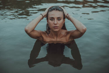 Portrait of young blond woman bathing in a lake - ACPF00626