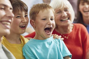 Three generations family having fun at home - MCF00246
