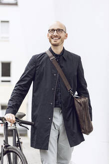 Man with bicycle going to work - MCF00269