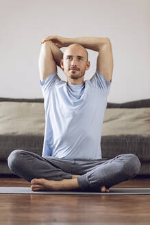 Man doing yoga at home - MCF00302