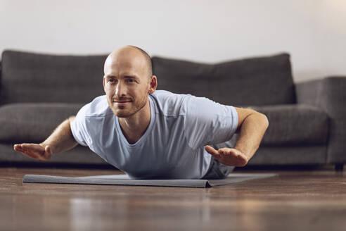Man doing yoga at home - MCF00305