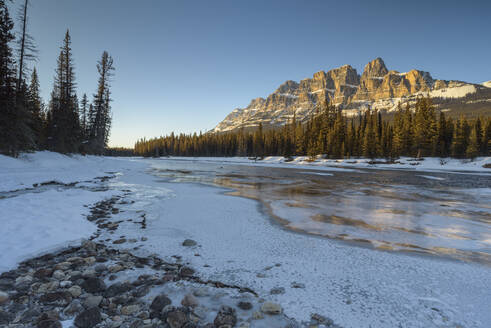 Sunset at Castle Mountain with frozen Bow River in winter, Banff National Park, UNESCO World Heritage Site, Alberta, Canadian Rockies, Canada, North America - RHPLF07150