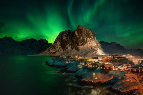 Aurora Borealis (Northern Lights) above Rorbuer fishermen's huts, Hamnoy, Moskenesoya, Lofoten Islands, Nordland, Norway, Europe - RHPLF07312