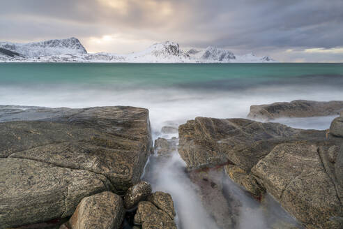A long exposure at Haukland Beach with moody sky, Lofoten, Nordland, Arctic, Norway, Europe - RHPLF07387