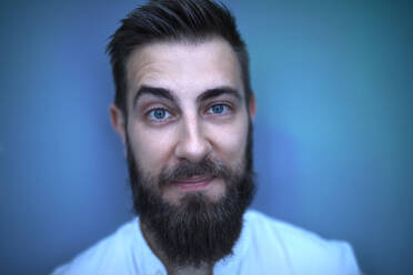 Portrait of bearded man in blue light - ZEDF02575