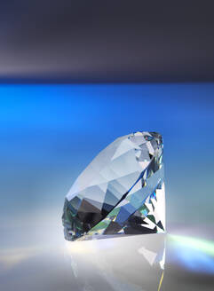 Close-up of diamond on table against black background - ABRF00498