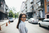 Portait of happy young businesswoman on the street - OYF00047