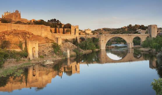 Puente de San Martin Bridge and San Juan des los Reyes Monastery reflected in the Tajo River, Toledo, Castilla-La Mancha, Spain, Europe - RHPLF07448