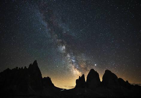 Scenic view of silhouette Tre Cime Di Lavaredo against star field at night, Veneto, Italy - LOMF00895