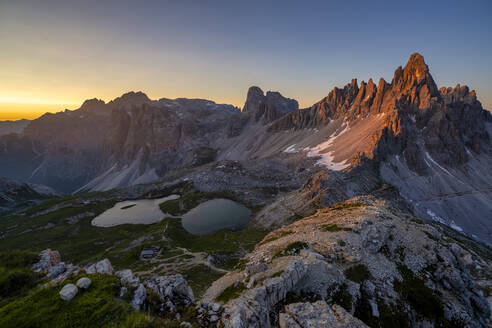 Scenic view of Tre Cime Di Lavaredo and Paternkofel against clear sky at sunset, Italy - LOMF00898
