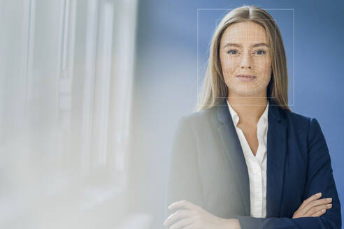 Facial recognition, businesswoman with grid over her face - KSHSF00008