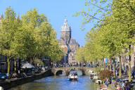 The Old Church (Oude Kerk) framed by boats and bridges in a canal of the river Amstel, Amsterdam, Holland (The Netherlands), Europe - RHPLF07776