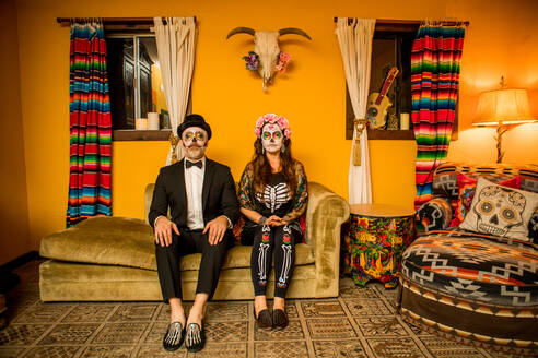 Man and woman in Dia de los Muertos makeup and costume, Day of the Dead celebration in the desert, California, United States of America, North America - RHPLF08496