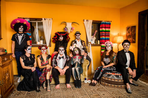 Group of friends in Dia de los Muertos makeup and costume, Day of the Dead celebration in the desert, California, United States of America, North America - RHPLF08499