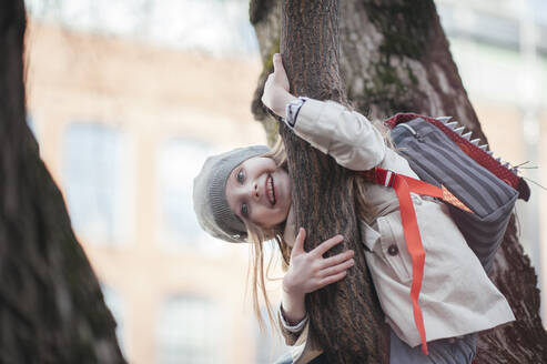 Portrait of happy girl in a tree - EYAF00447
