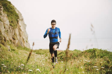 Trail runner training in nature, Ferrol, Spain - RAEF02293