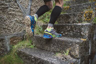 Detail of a runner on stairs outdoors - RAEF02299