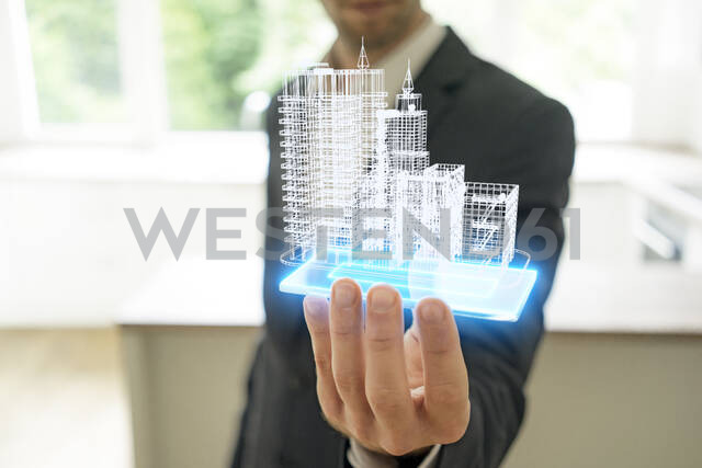 Businessman holding hologram of architectural model - KSHSF00012 - MAGIC UNICORN/Westend61