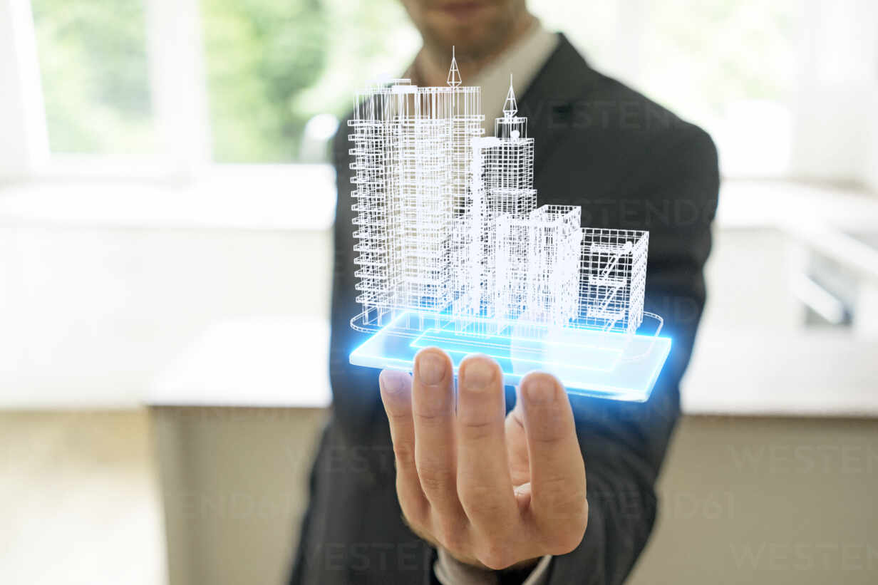Businessman holding hologram of architectural model - KSHSF00012 - MAGIC UNICORN/Westend61