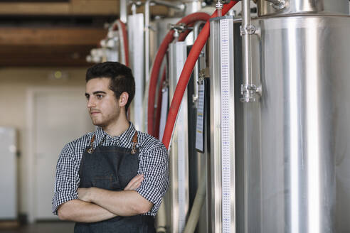 Portrait of young brewer at a brewery - ALBF01074