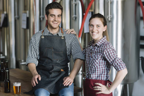 Portrait of happy young entrepreneurs at a brewery - ALBF01098