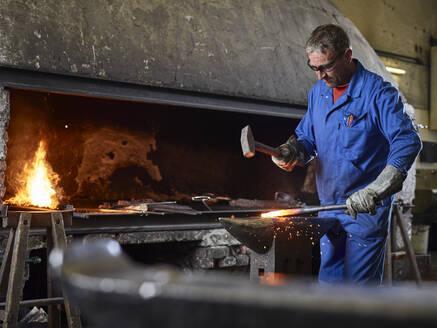 Blacksmith hammering hot iron - CVF01486