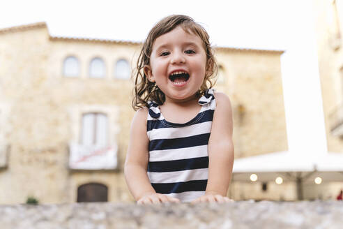 Portrait of happy little girl in summer wearing a striped dress - GEMF03132